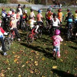 Elsie and Lily prepare for Under 12s Cyclocross